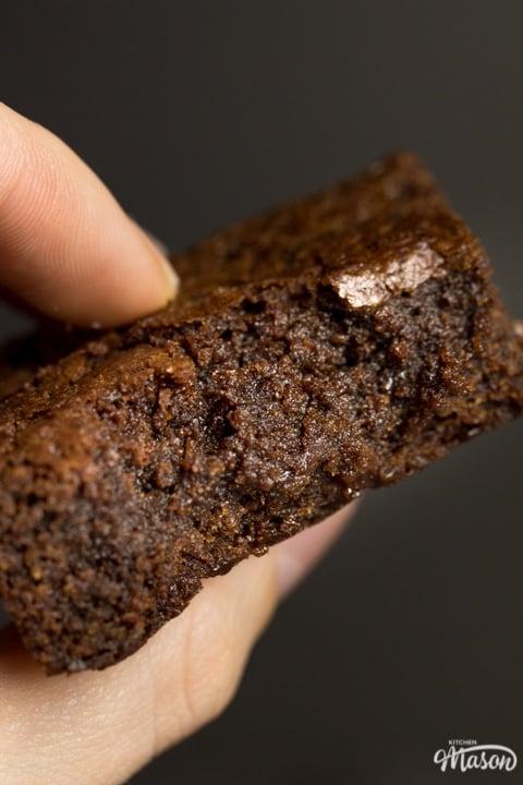 fudgy vegan gluten free brownie being held