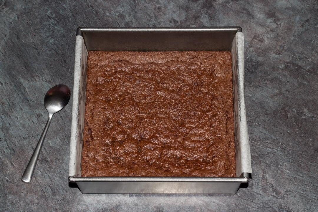 baked vegan gluten free brownies in a baking tin
