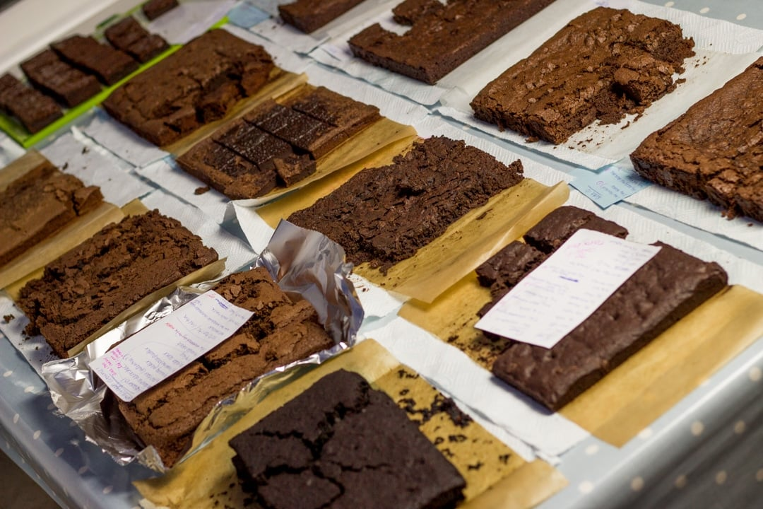 Lots of batches of vegan gluten free brownies on a table