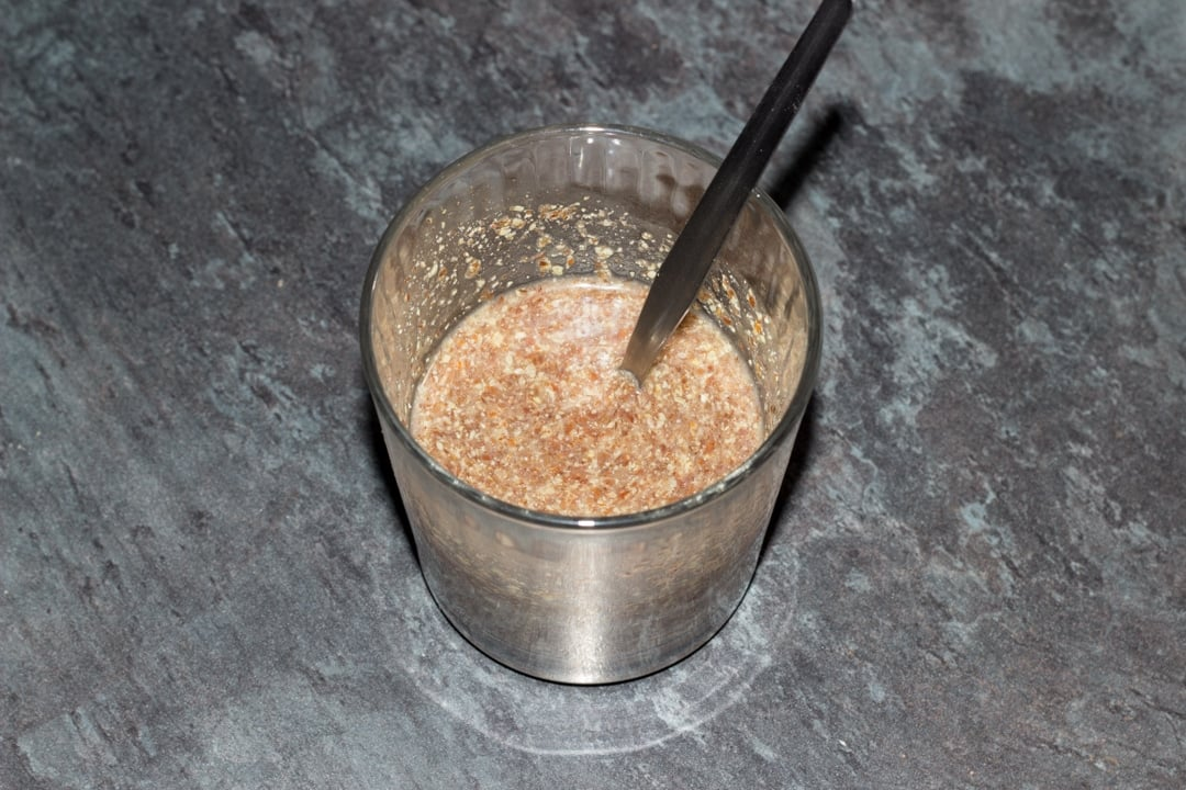 milled flaxseed and water in a glass