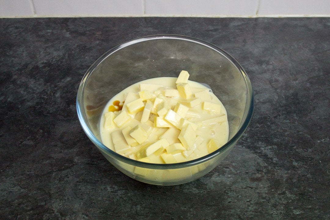 white chocolate, butter, condensed milk and vanilla in a glass bowl