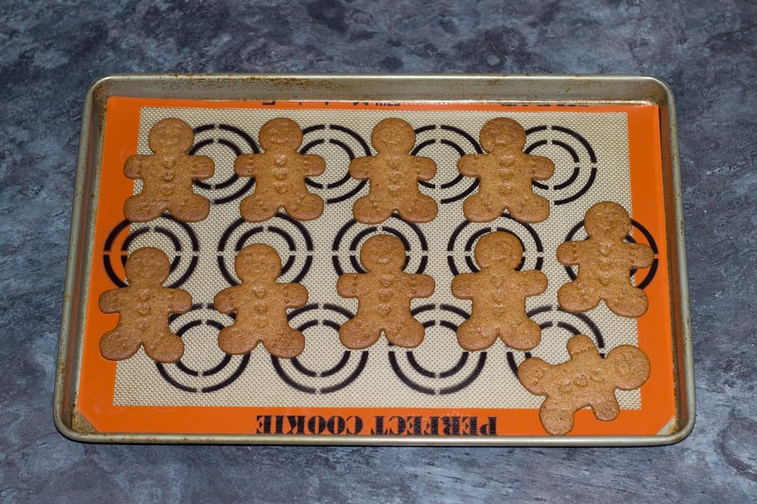 easy gingerbread recipe: baked gingerbread men on a baking tray