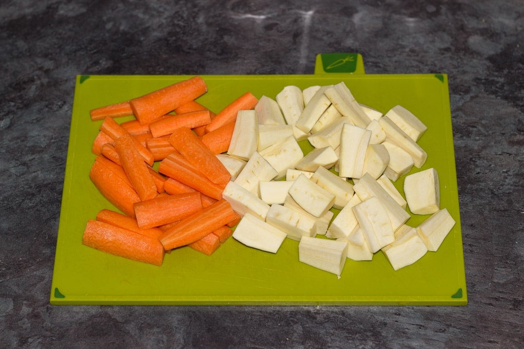 chopped carrots and parsnips on a chopping board