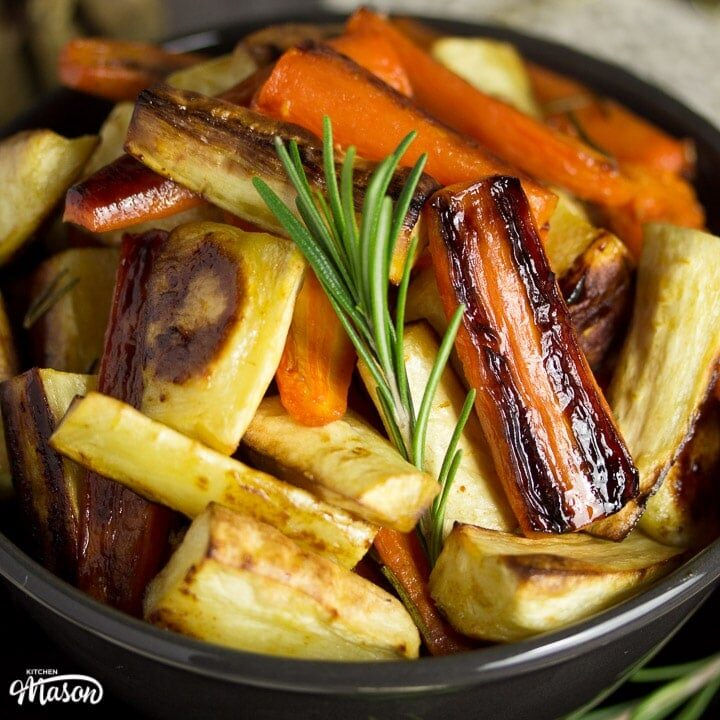 Honey roast parsnips and carrots with rosemary in a bowl