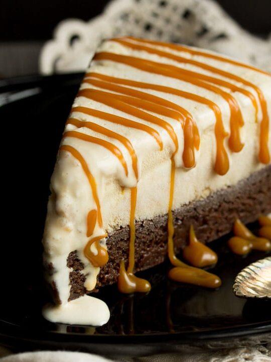 Slice of Salted Caramel Brownie Ice Cream Cake on a black plate
