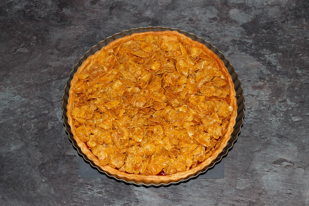 a prepared cornflake tart ready to be baked in the oven