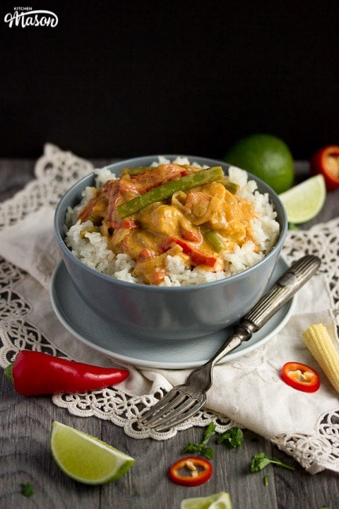 vegetable thai red curry in a grey bowl with rice