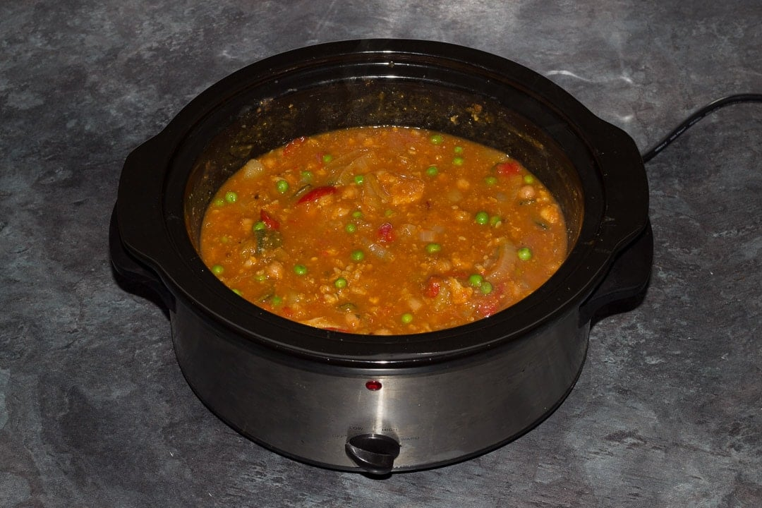 Cooked slow cooker vegetable curry in a slow cooker