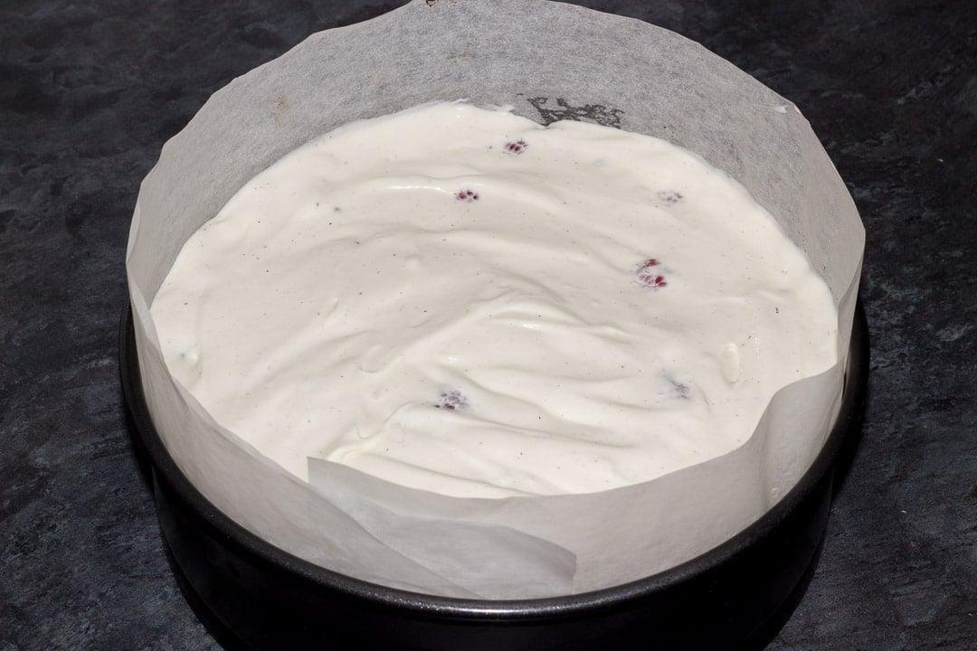vegan gluten free raspberry brownie ice cream cake in a lined baking tin