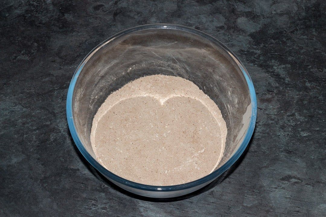 flour, cocoa powder, sugar, baking powder, xanthan gum and salt mixed together in a large glass bowl