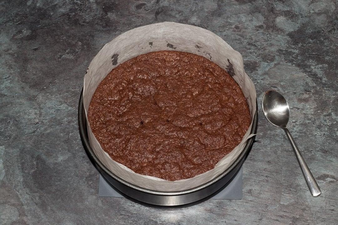 Baked vegan gluten free raspberry brownie in a baking tin