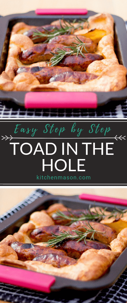 Toad in the hole in a roasting tray on a black and white tea towel