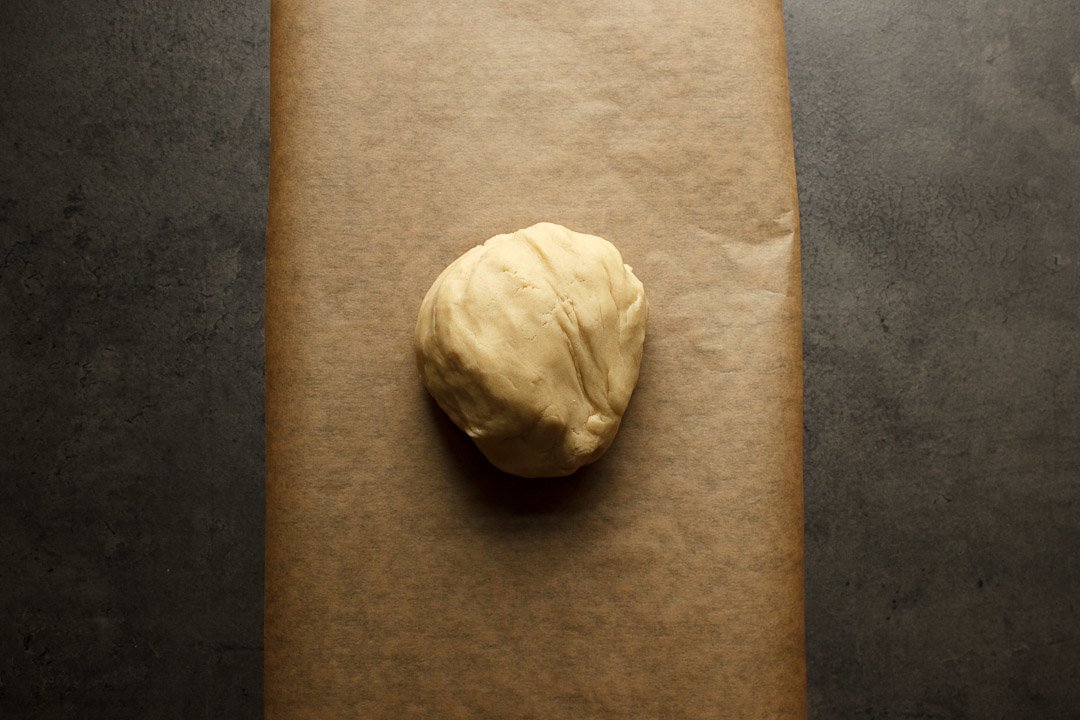 shortbread cookies dough on a sheet of baking paper