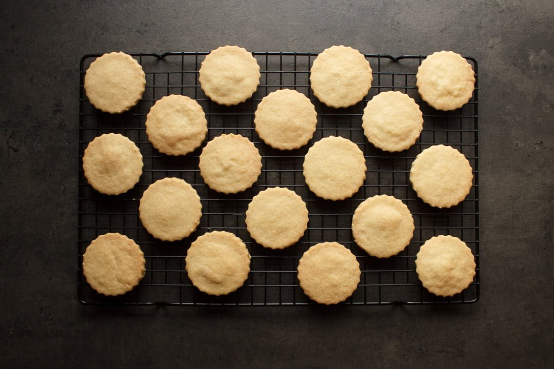 baked shortbread cookies cooling on a rack