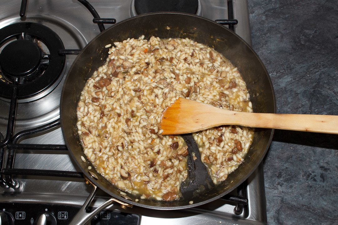 cooked wild mushroom risotto in a large saute pan