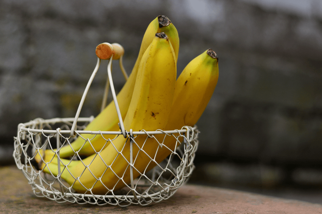 3 bananas in a wire basket