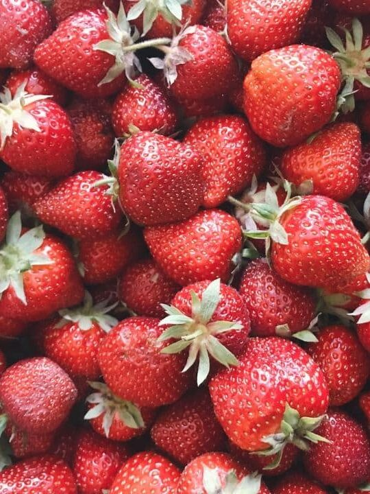 lots of strawberries in a large pile