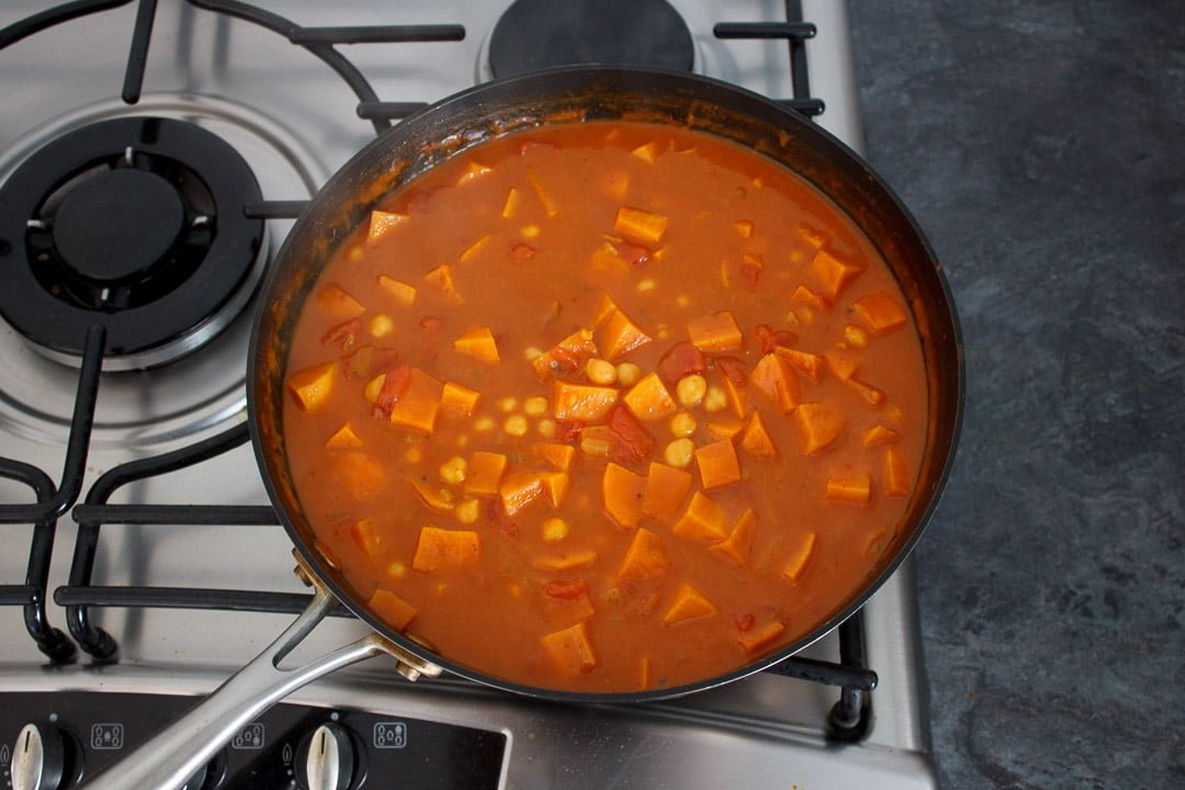 sweet potato chickpea curry in a frying pan