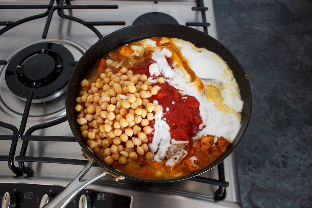 sweet potato chickpea curry ingredients all in a frying pan