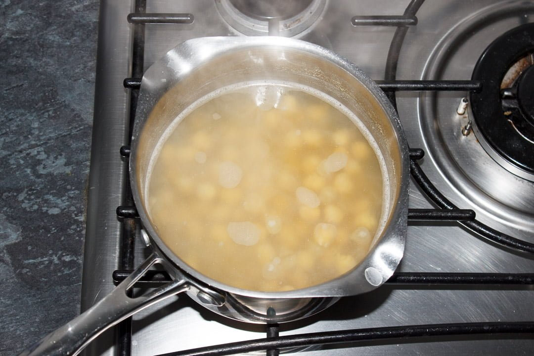Boiled chickpeas in a pan of water