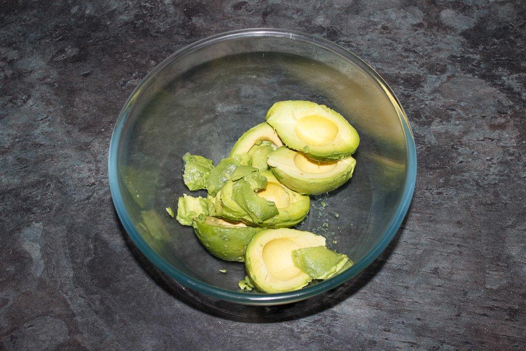 Avocado flesh in a glass bowl