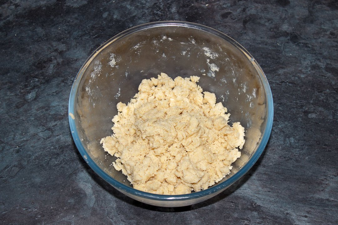 Shortcrust pastry dough in a glass bowl