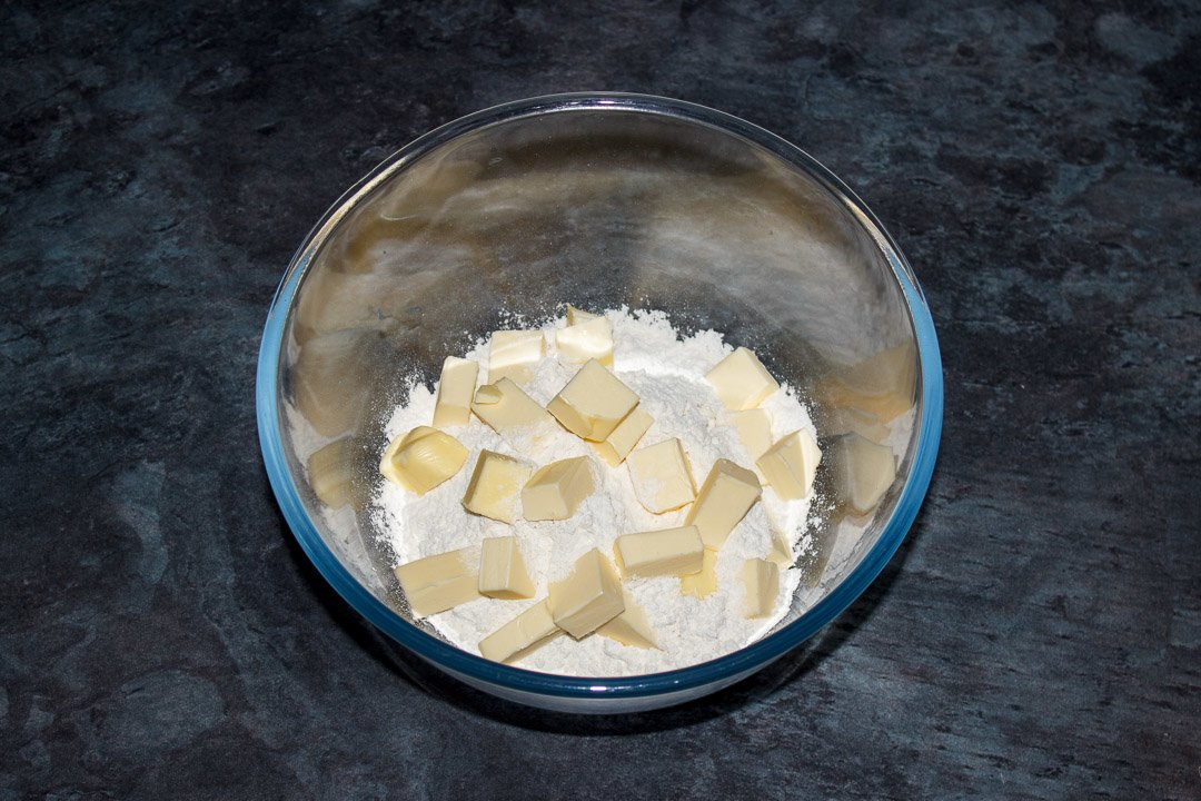 Butter, flour and salt in a glass bowl
