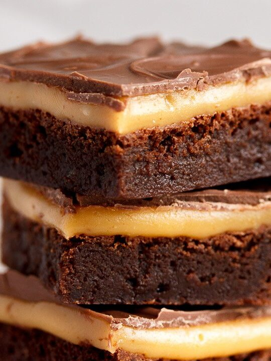 Millionaire brownie bars in a stack