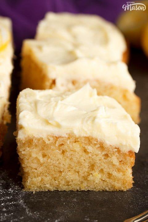 Sliced of lemon traybake cake on a worktop