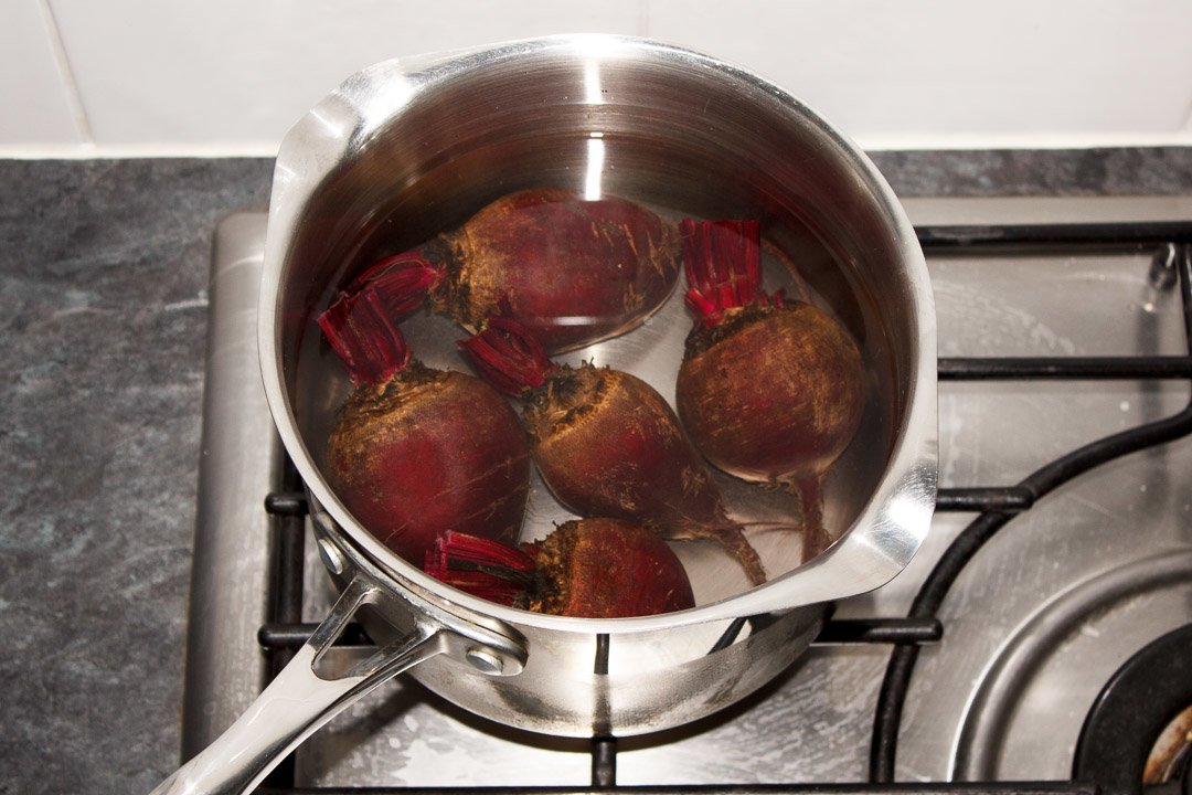 Washed whole beetroot with the stems trimmed in a large saucepan covered with water