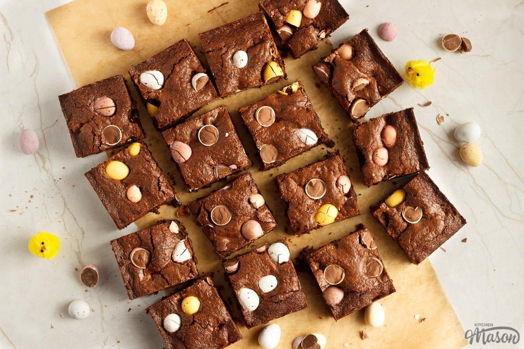 Mini Egg brownies sliced into bars on baking paper