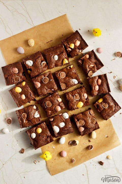 Mini Egg brownies sliced into bars on baking paper