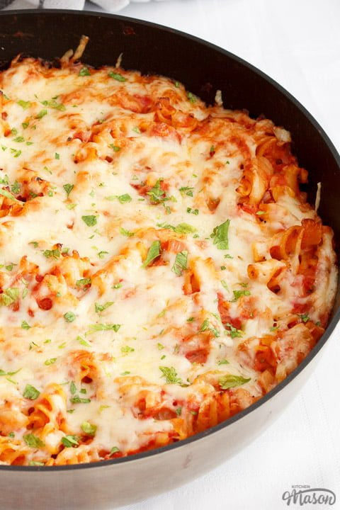 Tuna pasta bake in a large frying pan on a white table cloth