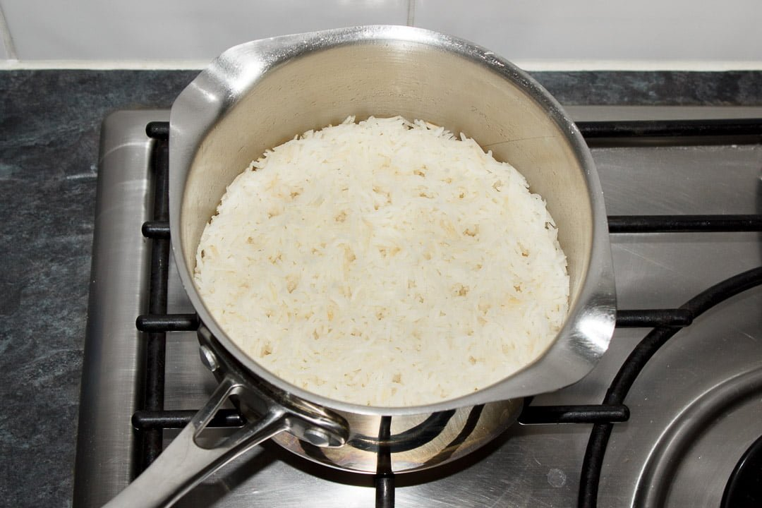 freshly cooked rice in a saucepan
