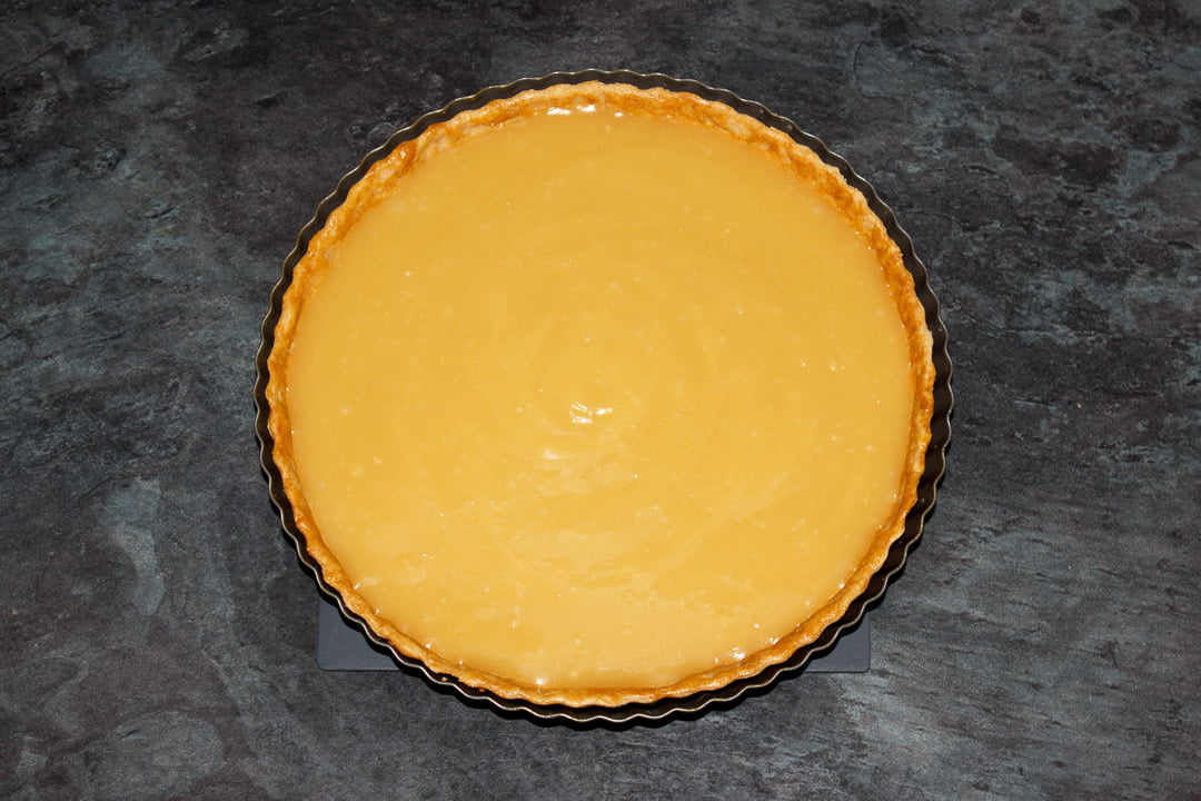 Butterscotch tart in a round fluted tart tin