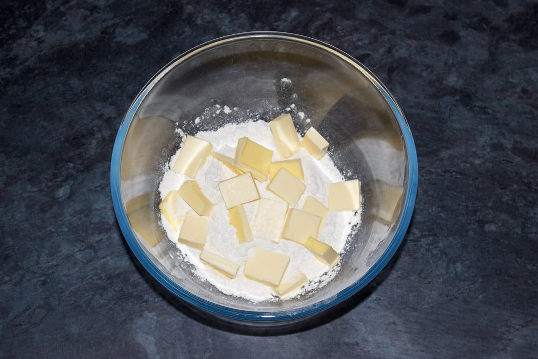 Cubed butter, flour and salt in a glass bowl
