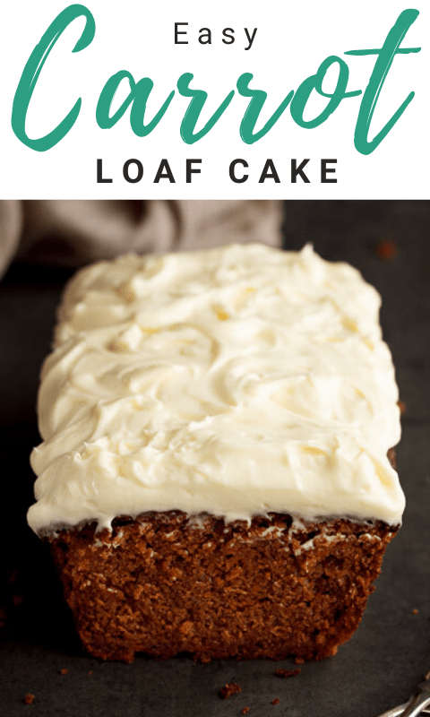 Carrot loaf cake topped with cream cheese frosting on a worktop with a cloth in the background