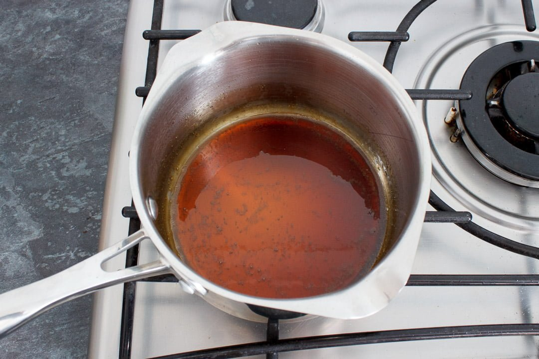 Soy sauce, mirin and caster sugar simmering in a small saucepan