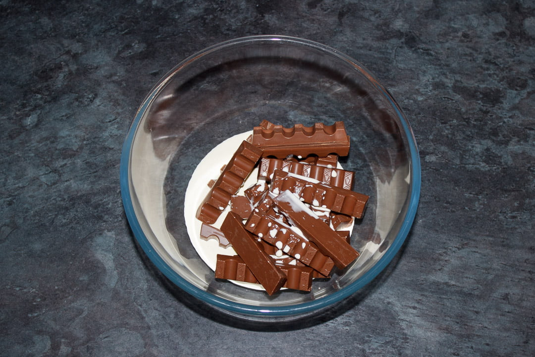Double cream and Kinder bars in a glass bowl