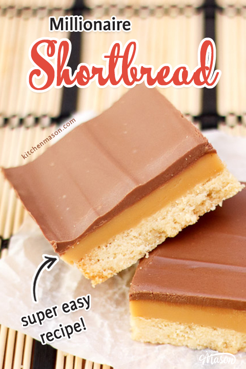 A piece of millionaire shortbread stacked on top of another on a cream and white placemat.
