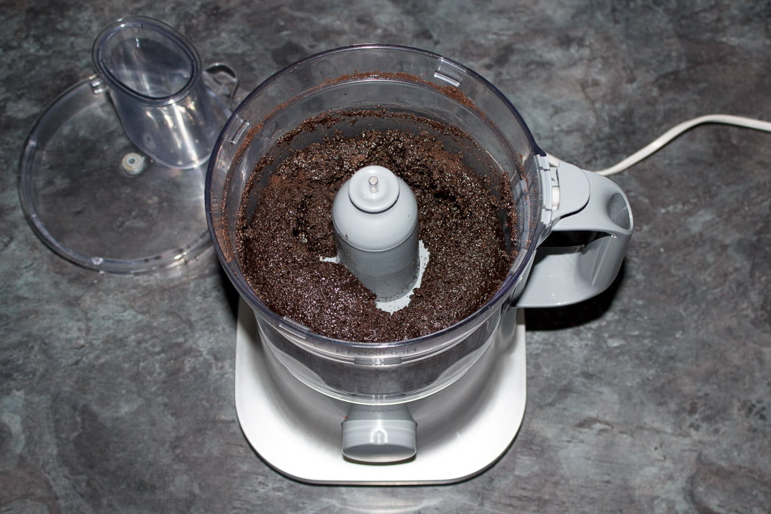 Crushed Oreos in a blender with melted butter