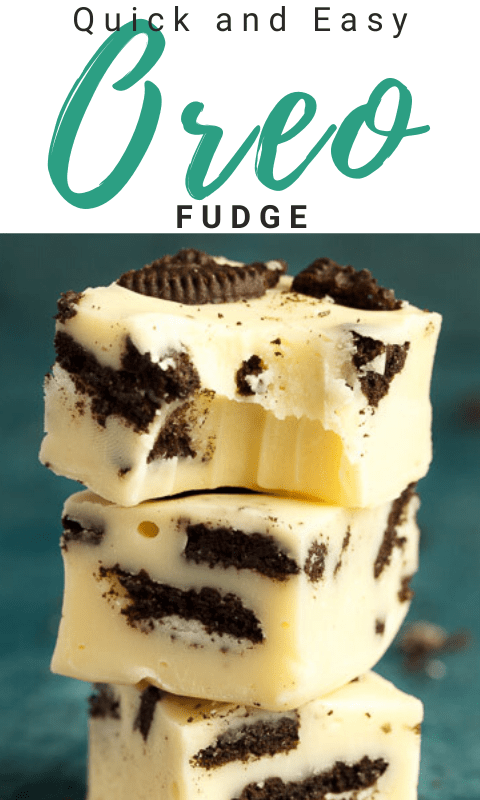Oreo fudge in a stack of 3, the top piece has a bite out of it