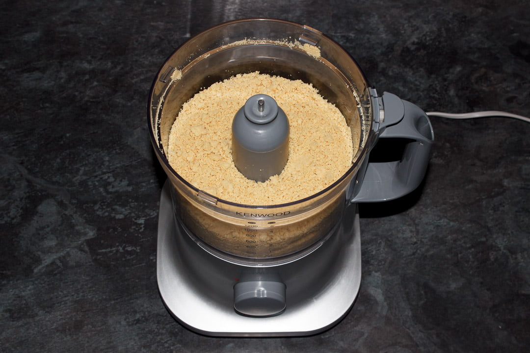 Crushed biscuit crumbs in a food processor