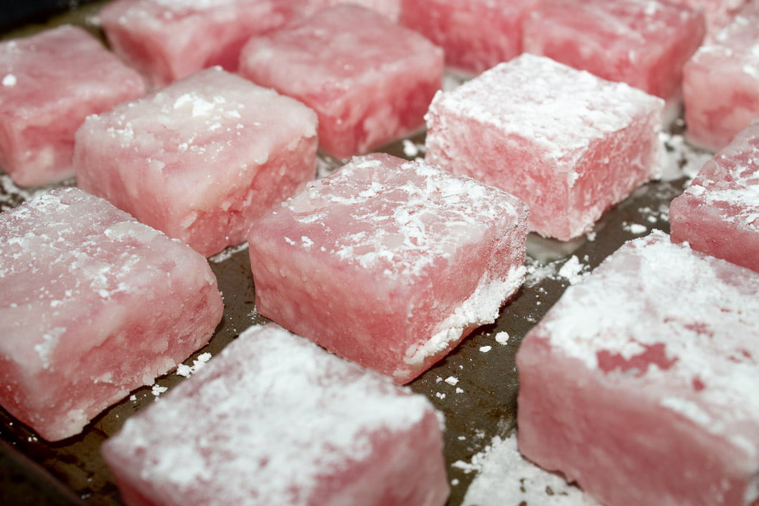 Turkish delight cubes on a baking tray with a cornflour crust on them