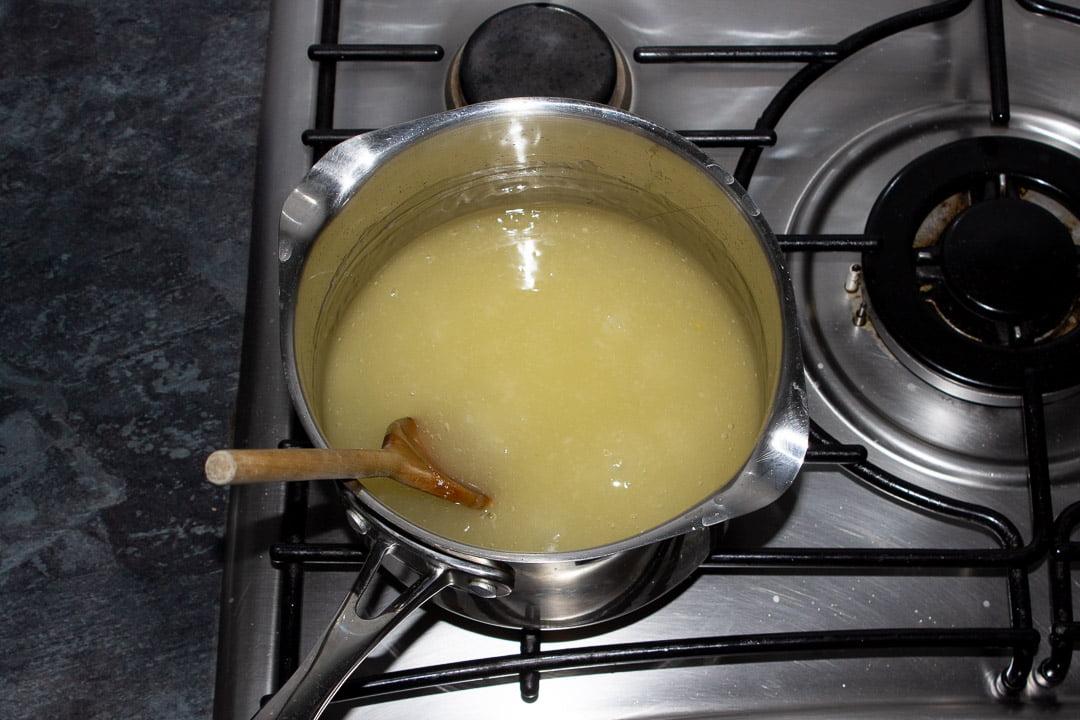 Sugar, lemon juice, water, cornflour and gelatine thickening in a saucepan on a hob