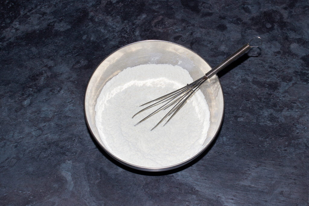 Flour, bicarbonate of soda and salt whisked together in a metal bowl