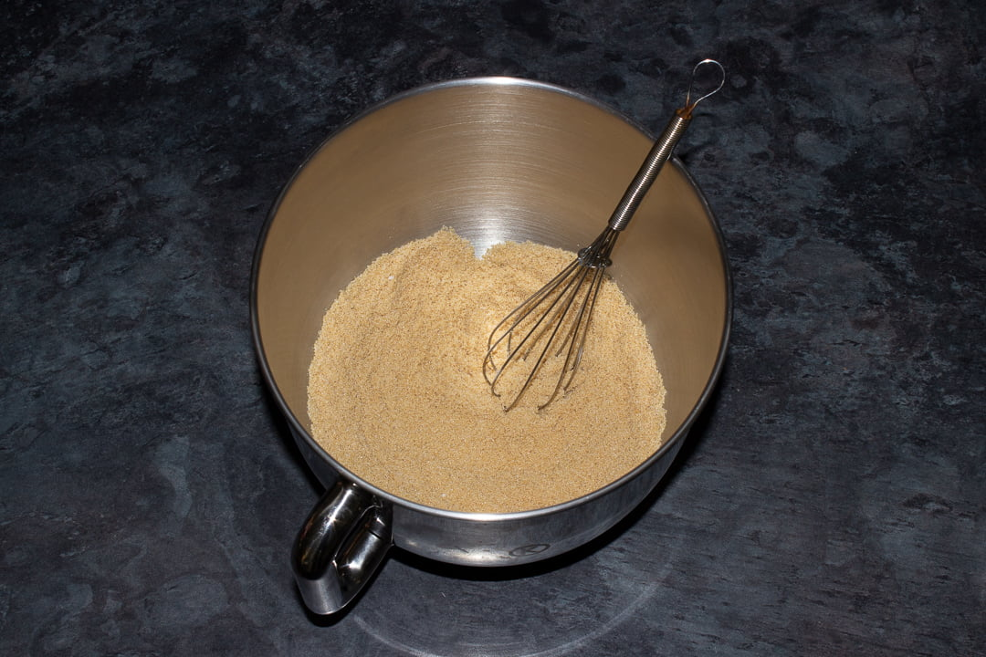 Soft light brown sugar and caster sugar whisked together in the bowl of an electric stand mixer with a hand whisk