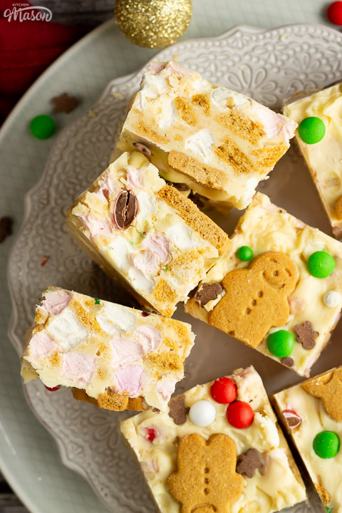 Squares of Christmas rocky road on a lace white plate with Christmas sprinkles scattered around