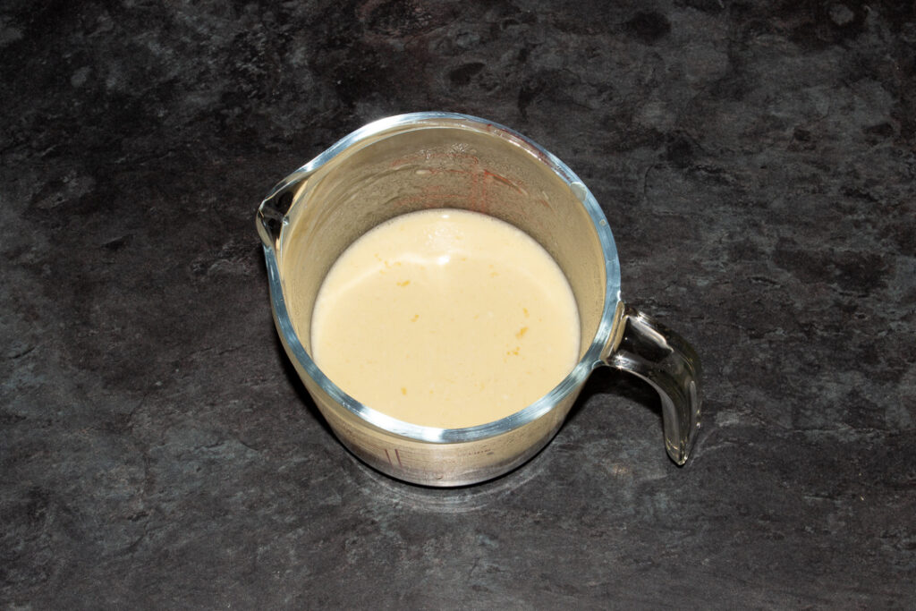 Yorkshire pudding batter in a glass jug
