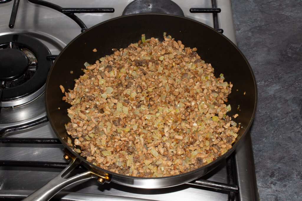 Cooked onion, garlic and soya mince in a frying pan
